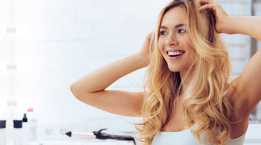 Garnier Hair Color How to Care for Dyed Hair Woman Long Blond Hair with Curls