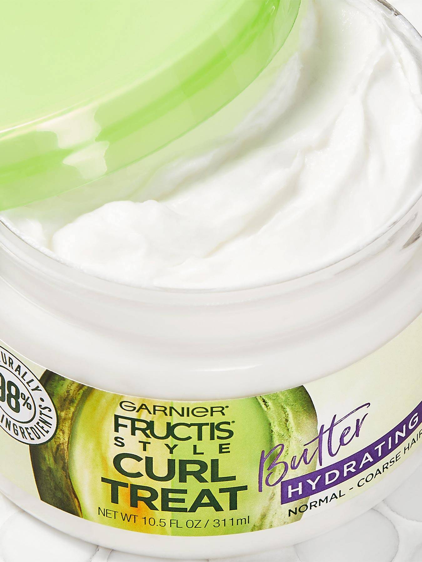 Close up view of Curl Treat Butter Hydrating Leave-in Styler to Shape Curls.