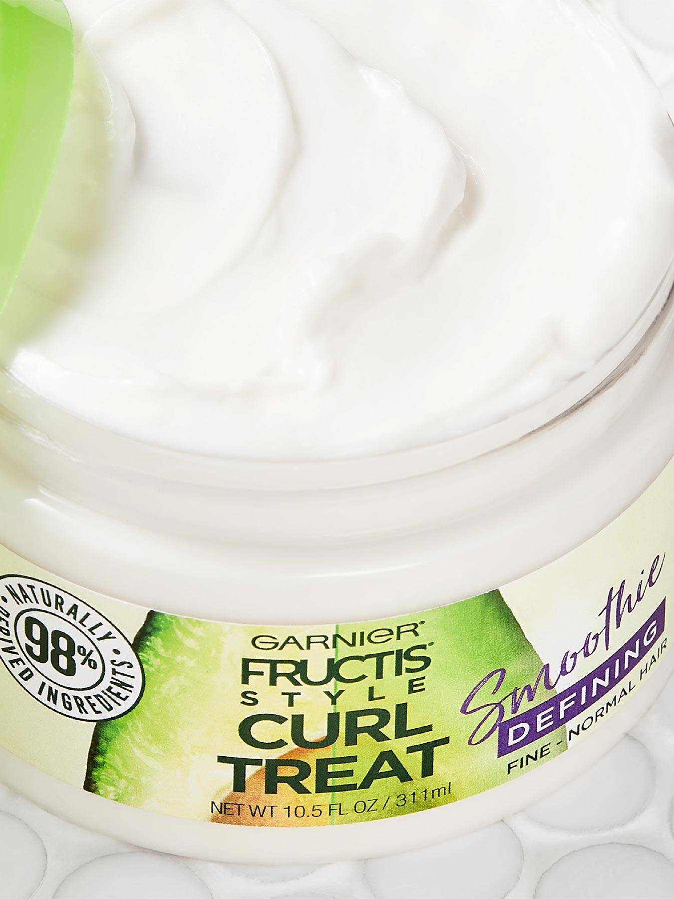 Close up view of Curl Treat Smoothie Defining Leave-in Styler for Soft Curls.
