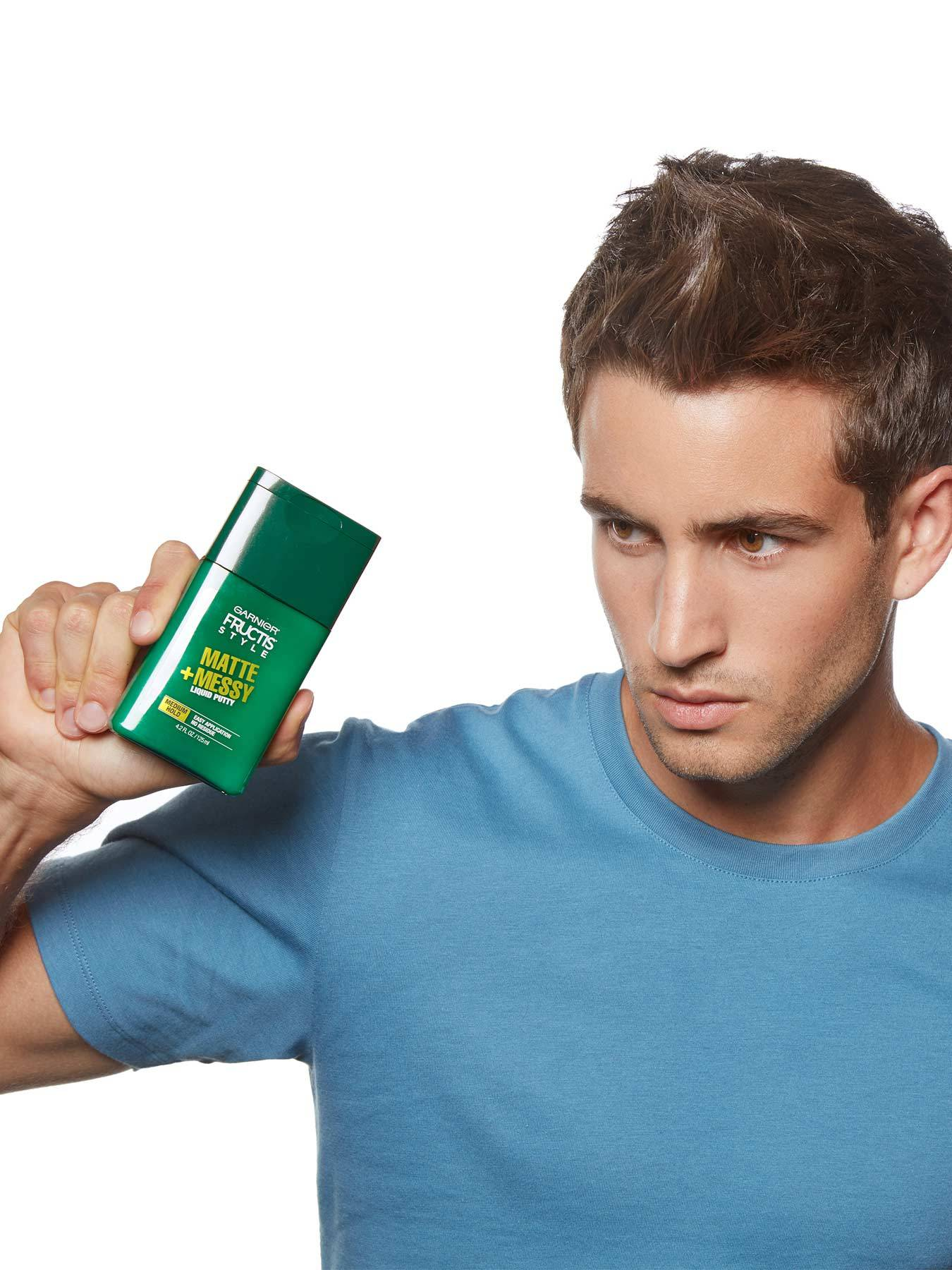 Model holding Matte and Messy Liquid Hair Putty for Men, No Drying Alcohol.