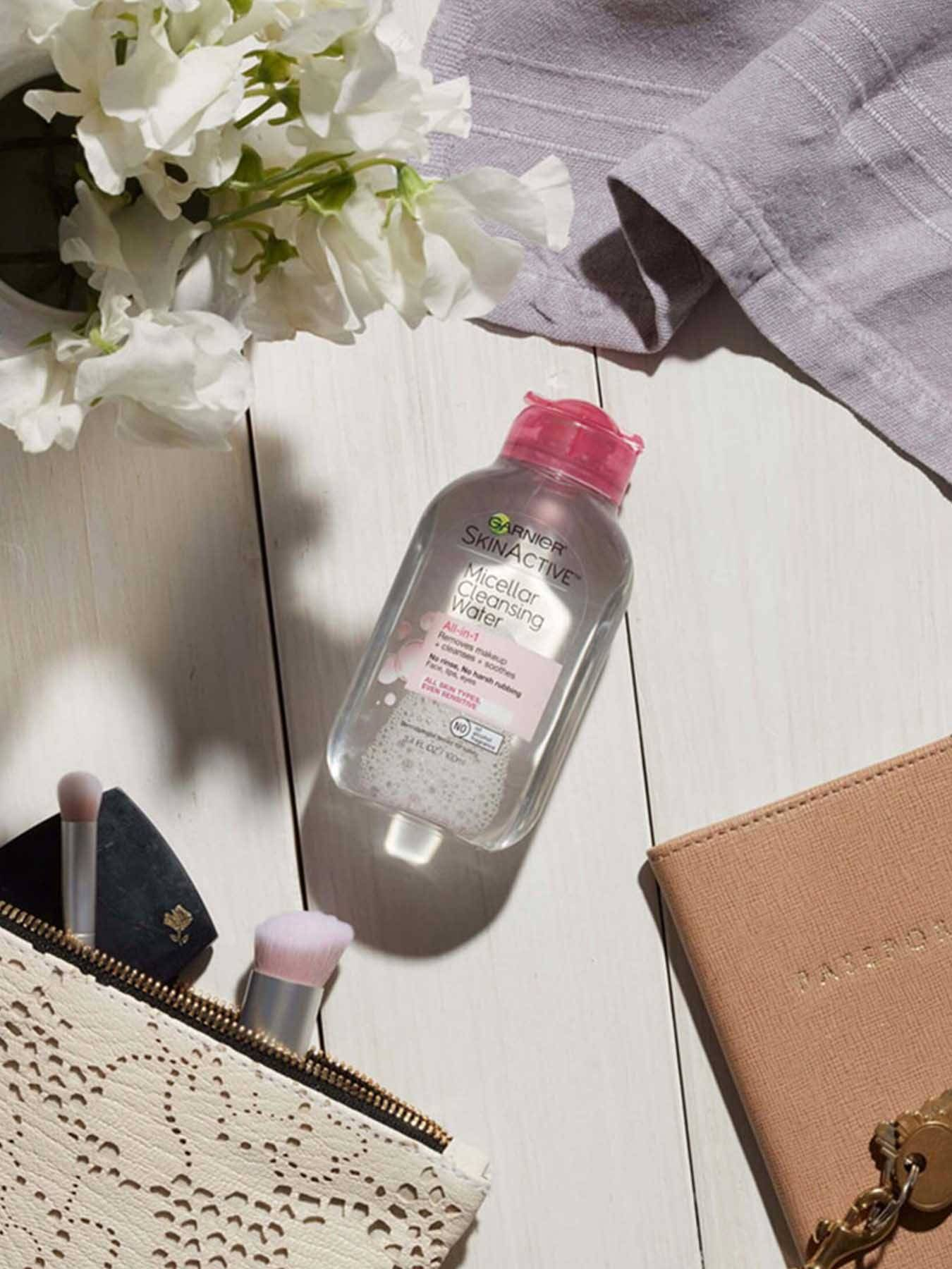 In Use view of Pink Cap Cleansing Water All-in-1, All Skin Types.
