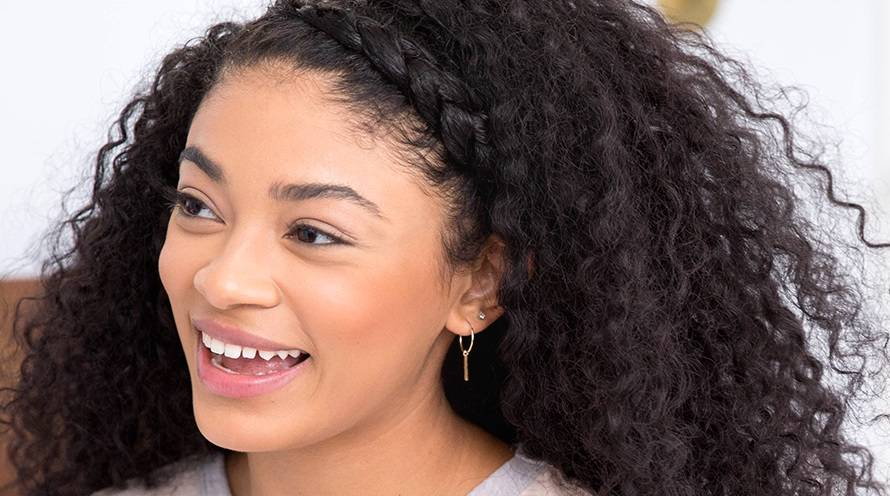 Garnier Woman with Black curly hair crown braid